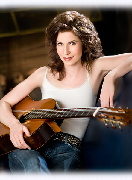 Sharon Isbin Sitting with Guitar